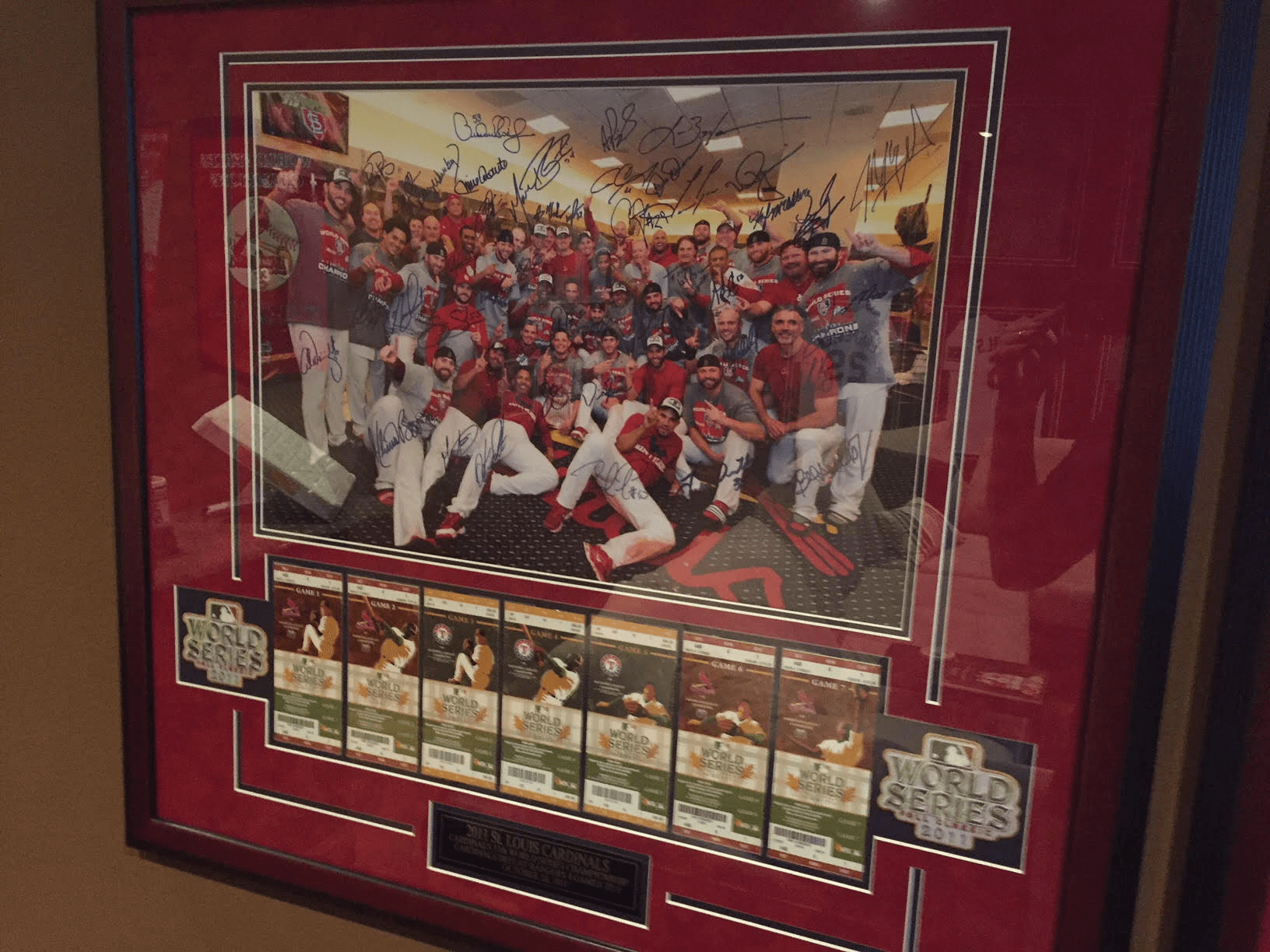 Trading cards framed on wall
