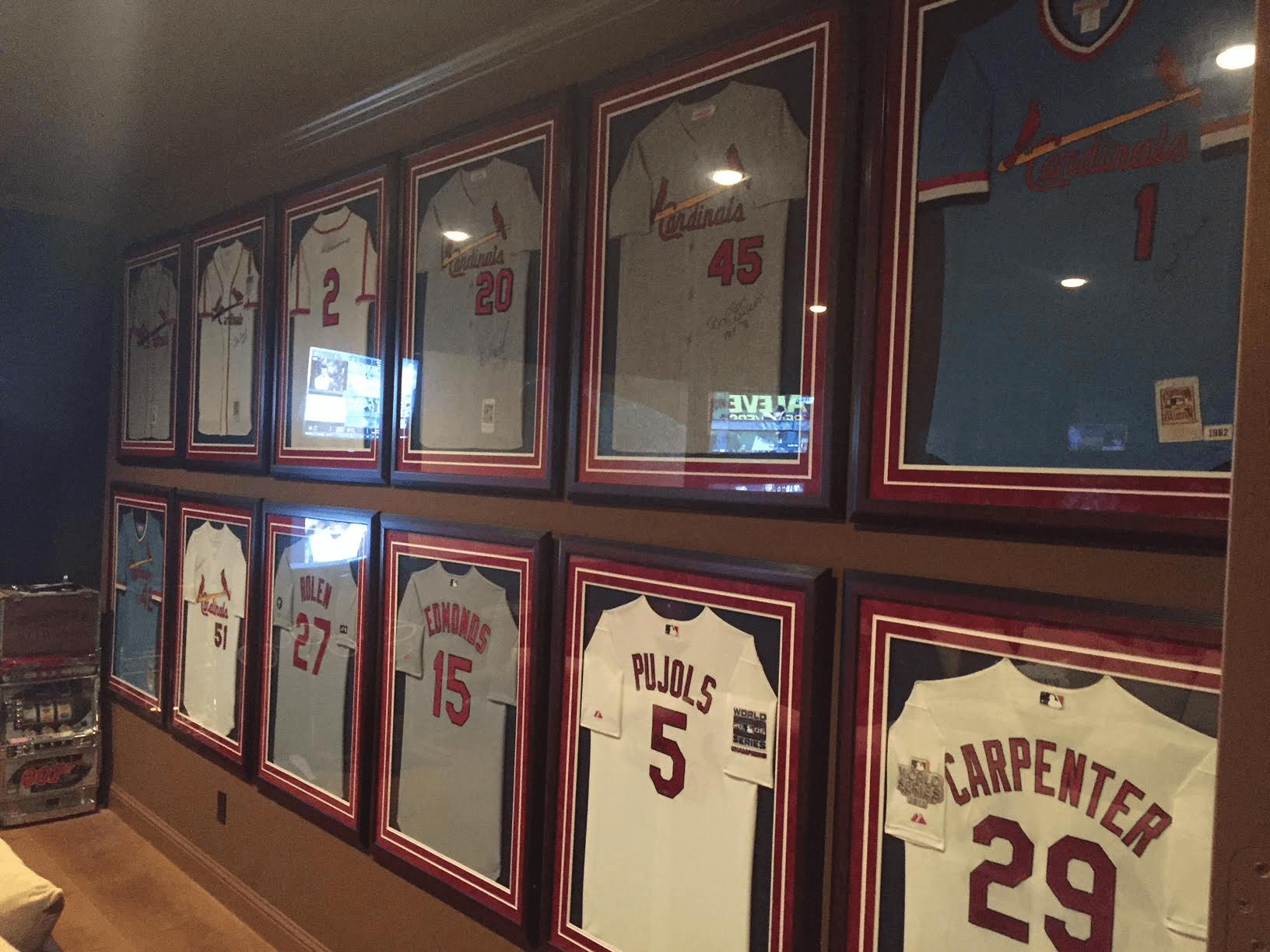 Framed Cardinals jerseys on wall