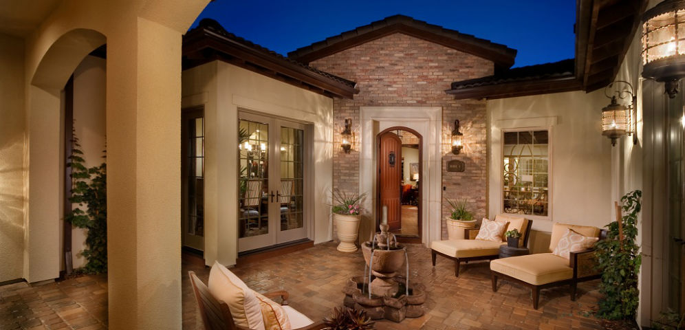 Home of the week overlook plan four by celebrity communities for Homes with courtyards in the middle
