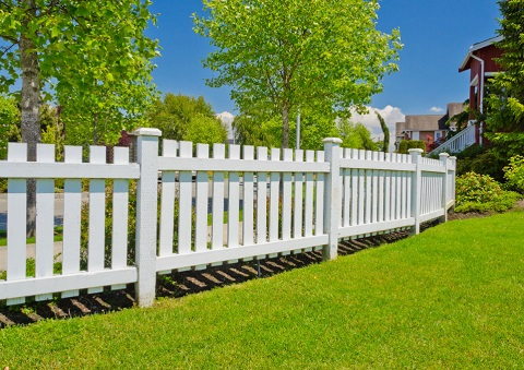 White Picket Fence and Lush Green Lawn