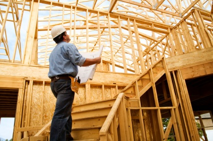 Man looking up in constructed home