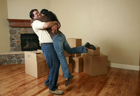 First time homebuyers hugging and celebrating new home