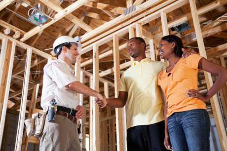 Builder Shaking Hands With Couple